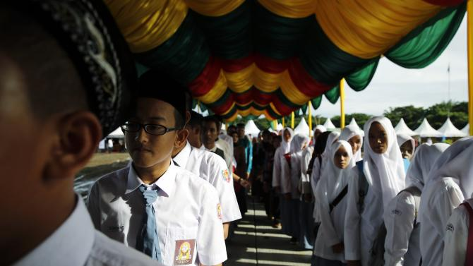 Students stand in line as they attend a ceremony to commemorate the 10th anniversary of the tsunami in Banda Aceh