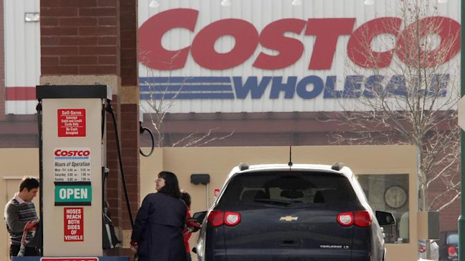 In this Feb. 7, 2012 photo, Costco members pump gas outside a Costco Wholesale store in West Homestead, Pa. Wholesale businesses increased their stockpiles sharply in December although the gains are expected to slow in coming months, a development that could slow overall economic growth.  (AP Photo/Gene J. Puskar)