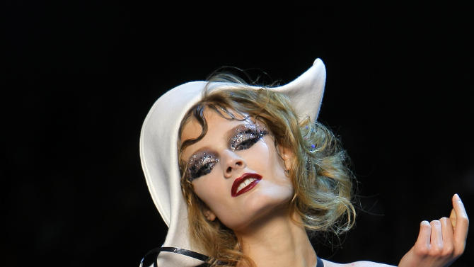 A model wears a creation by Christian Dior for the Fall-Winter 2011-2012 Haute Couture fashion collection presented in Paris, Monday, July 4, 2011. (AP Photo/Jacques Brinon)
