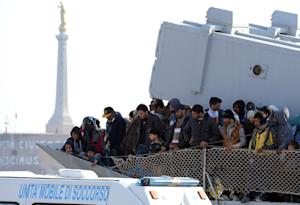 A boat transporting migrants arrives in the port of…