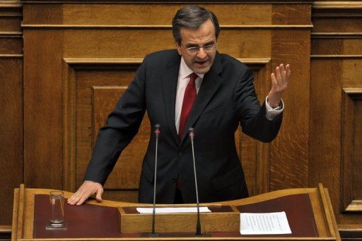 <p>Greek Prime Minister Antonis Samaras gives a final speech at the Greek parliament in Athens. The coalition government of Samaras won a largely symbolic confidence vote on Sunday, picking up a comfortable mandate to tackle the country's two-year-old crisis.</p>