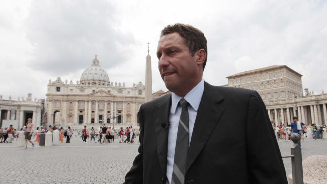 FILE - In this Aug. 13, 2012 file photo Paolo Gabriele's lawyer Carlo Fusco is interviewed near St. Peter's square at the Vatican. Fusco's lawyer for the pope's ex-butler, who is facing trial for his role in the Vatican leaks scandal, has resigned. Attorney Carlo Fusco said Thursday, Aug. 30, 2012 he had quit as Paolo Gabriele's attorney over differences in defense strategy. It wasn't immediately clear if Gabriele's other lawyer, Cristiana Arru, was remaining on as counsel. A Vatican judge earlier this month ordered Gabriele to stand trial for allegedly stealing documents from Pope Benedict XVI's private apartment. (AP Photo/Gregorio Borgia, File)