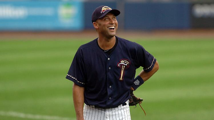 New York Yankees shortstop Derek Jeter laughs during warmups for a rehab baseball game with the Scranton/Wilkes-Barre RailRiders, against the Rochester Red Wings on Wednesday, July 10, 2013, in Moosic, Pa. (AP Photo/Scranton Times-Tribune, Butch Comegys) WILKES-BARRE TIMES-LEADER OUT MANDATORY CREDIT