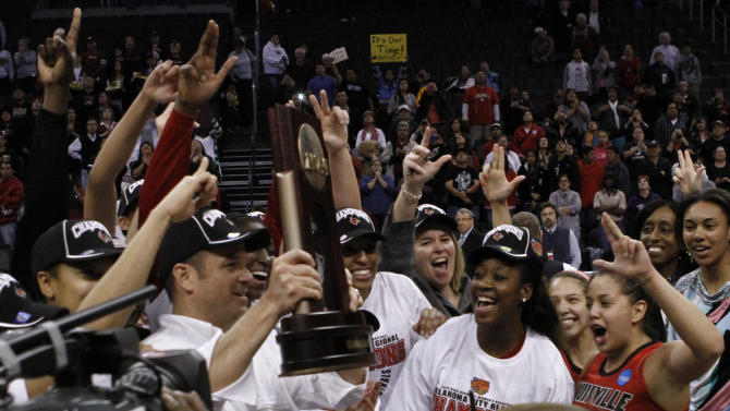 Louisville's team celebrates after defeating Tennessee during the Oklahoma City regional final game in the women's NCAA college basketball tournament in Oklahoma City, Tuesday, April 2, 2013.   Louisville own 86-78.  (AP Photo/Alonzo Adams)