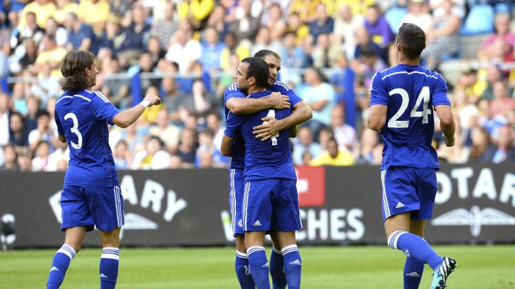 Chelsea's players celebrate a goal against Vitesse Arnhem during their friendly soccer match in Arnhem