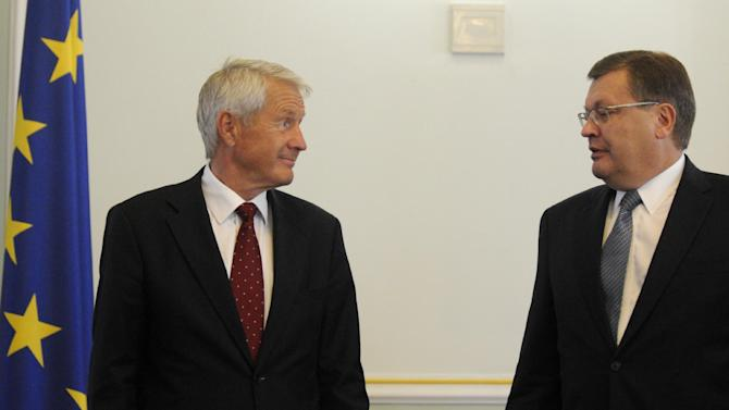 Council of Europe Secretary General Thorbjorn Jagland, left, and Ukraine's Foreign Minister Kostyantyn Gryshchenko arrive for a press conference in Kiev, Ukraine, Monday, Sept. 10, 2012. The head of Europe's top human rights watchdog is urging the Ukrainian authorities to conduct a free and fair parliamentary election in October. The election has been tainted by the jailing of former Prime Minister Yulia Tymoshenko on abuse-of-office charges the West condemned as politically motivated. (AP Photo/Sergei Chuzavkov)