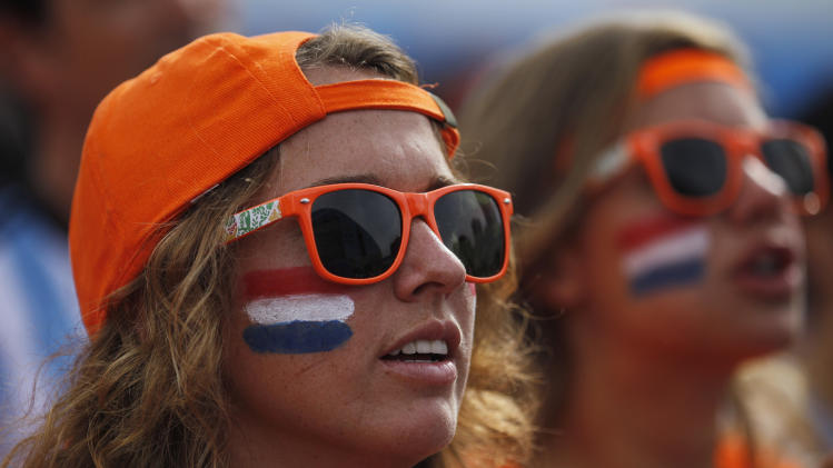 Dutch soccer fans watch a live broadcast of the group B World Cup match between Chile and Netherlands, inside the FIFA Fan Fest area on Copacabana beach, in Rio de Janeiro, Brazil, Monday, June 23, 2014. (AP Photo/Leo Correa)