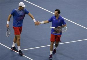 Czech Republic's Berdych and Stepanek celebrate a point against stoy Serbia's Zimonjic and Bozoljac during their Davis Cup World Group final doubles tennis match in Belgrade