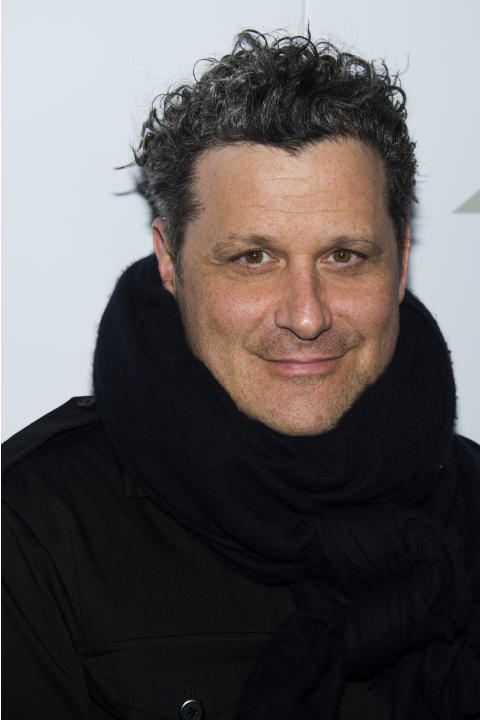 "FILE - Isaac Mizrahi attends the ""Project Runway: All Stars"" third season launch in this Oct. 22, 2013 file photo taken in New York. The fashion celebrity has a deal with Amy Einhorn Books f"