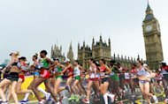 Women's marathon competitiors pass Big Ben and the Palace of Westminster. Ethiopia's Tiki Gelana won gold in the women's marathon which was run through the streets of London on Sunday in an Olympic record time of 2hr 23min 7sec