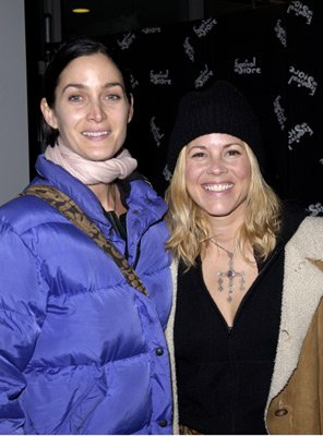 Carrie Anne Moss and Maria Bello