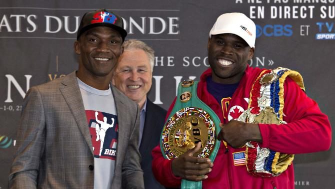 WBC light heavyweight champion Adonis Stevenson, right, and challenger Sakio Bika pose at a news conference for their  title fight in Quebec City, Wednesday, April 1, 2015.The fight is scheduled for Saturday April 4 in Quebec City. Looking on at center rear is  promoter Yvon Michel. (AP Photo/The Canadian Press, Jacques Boissinot)