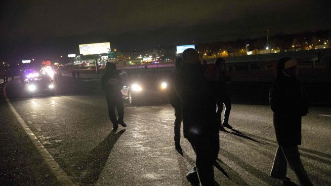Protesters shut down Highway 170 after a man was fatally shot by a policeman in Berkeley, Missouri