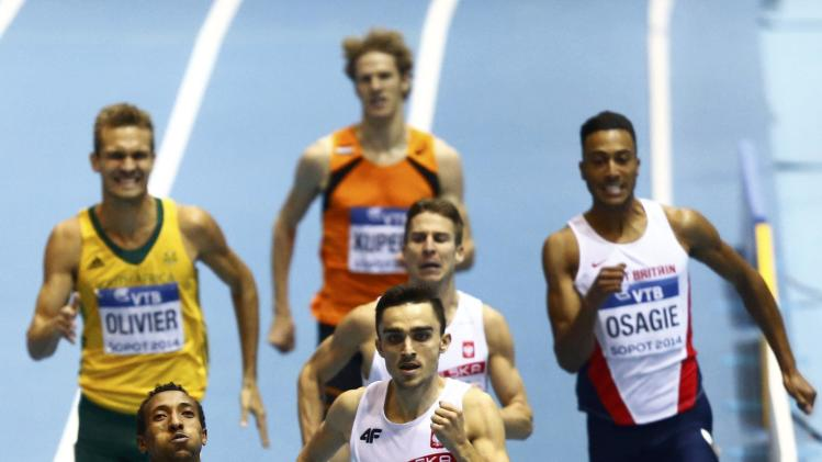 Ethopia's Aman sprints ahead of Poland's Kszczot to win men's 800m final at world indoor athletics championships in Sopot