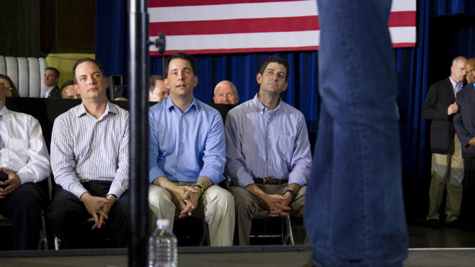 RNC chairman Reince Priebus , left, Gov. Scott Walker, R-Wis., center, and Rep. Paul Ryan, R-Wis., watch Republican presidential candidate, former Massachusetts Gov. Mitt Romney, speak during a campaign stop at Monterey Mills on Monday, June 18, 2012 in Janesville, Wis.  (AP Photo/Evan Vucci)