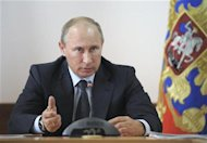Russia's President Vladimir Putin chairs a meeting on the aftermaths of recent floods in Krasnodar region in the Black Sea town of Gelendzhik July 25, 2012. REUTERS/Alexsey Druginyn/RIA Novosti/Pool