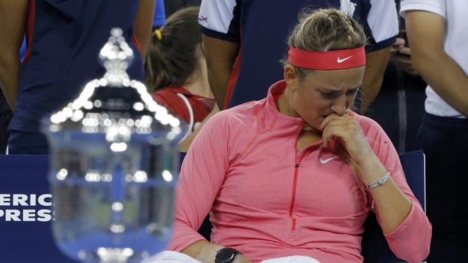 Azarenka of Belarus sits with a towel after being defeated by Serena Williams of the U.S. in their women's singles final match at the U.S. Open tennis championships in New York