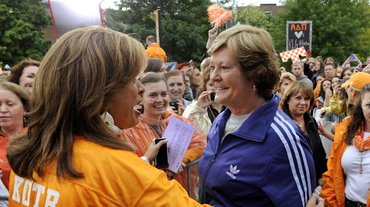"Hoda Kotb, left, the co-host of the fourth hour of NBC's ""Today"" show, greets Lady Vol coach emeritus Pat Summitt during a broadcast from the University of Tennessee Monday, Oct. 1, 2012, in Knoxville, Tenn. UT won an online contest sponsored by ""Today"" to bring Kotb and co-host Kathie Lee Gifford to town with their show. (AP Photo/Knoxville News Sentinel, Michael Patrick)"