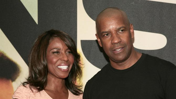 """Actor Denzel Washington, right, attends the premiere of """"Two Guns"""" with his wife actress Pauletta Washington, left, on Monday, July 29, 2013, in New York. (Photo by Andy Kropa/Invision/AP)"""