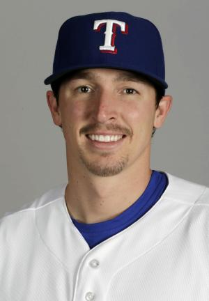 FILE - This is a 2013 file photo of Tanner Scheppers of the Texas Rangers. The Rangers say Scheppers sustained facial bruises after being attacked while walking in downtown Cleveland on Thursday night, July 25, 2013. (AP Photo/Charlie Riedel, File)