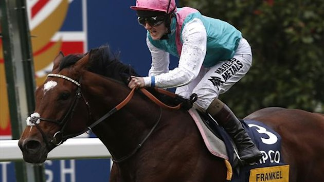 Quealy on Frankel celebrates after winning The Champion Stakes during the British Champions Day at Ascot