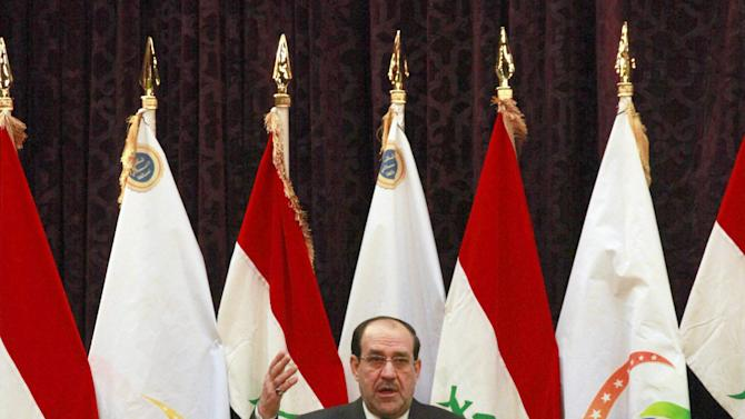 """Iraqi Prime Minister Nouri al-Maliki speaks to the press in Baghdad, Iraq, Friday, Dec. 28, 2012. Iraq's Prime Minister warned against a return to sectarian conflict and cautioned that the country is close to returning to the """"dark days when people were killed because of their names or identities.""""(AP Photo/Hadi Mizban)"""