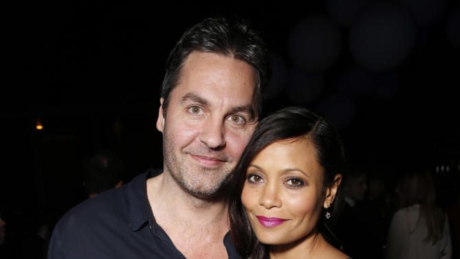 "Ol Parker and wife Thandie Newton attend the after party for the LA premiere of ""Rogue"" at the ArcLight Hollywood on Tuesday, March 26, 2013 in Los Angeles. (Photo by Todd Williamson/Invision/AP)"