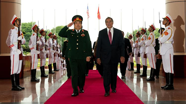 U.S. Defense Secretary Leon Panetta, center right, participates in an arrival ceremony with Vietnamese Defense Minister Phung Quang Thanh at the defense ministry in Hanoi, Vietnam Monday, June 4, 2012. (AP Photo/Jim Watson, Pool)