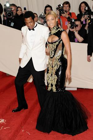 FILE -- In a may 2, 2011 file photo Beyonce Knowles and her husband Jay-Z arrive at the Metropolitan Museum of Art Costume Institute gala in New York.  Beyoncé and Jay-Z enjoyed a concert by R&B singer The-Dream Sunday March 11, 2012 in New York.  (AP Photo/Evan Agostini)