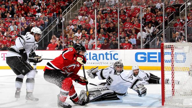 Zach Parise #9 Of The New Jersey Devils Goes For The Puck In Front Of Jonathan Quick #32 Of The Los Angeles Kings As  Getty Images