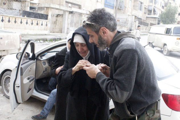 A mother of the member of a Free Syrian Army member reacts as she sees her son in Aleppo