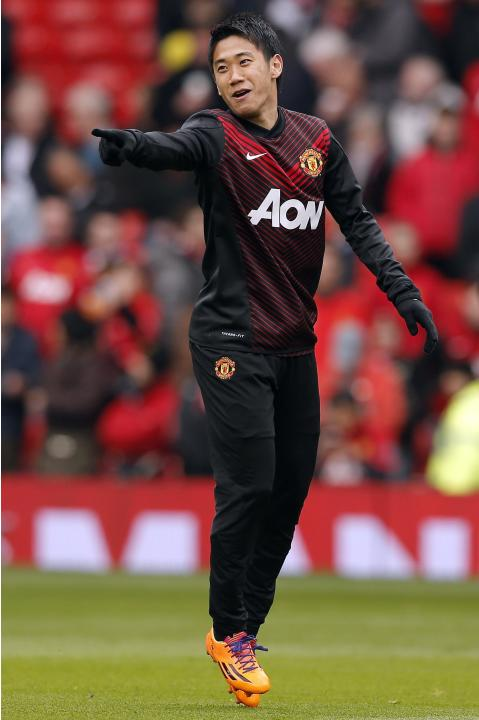 Manchester United's Kagawa gestures before their English Premier League soccer match against Liverpool in Manchester