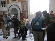 A Shaam News Network image shows UN observers at a hospital morgue in the central Syrian town of Houla on May 26. UN-Arab envoy Kofi Annan expressed &quot;horror&quot; at the Houla massacre of more than 100 people as he began a visit on Monday to the Syrian capital aimed at salvaging his battered peace plan