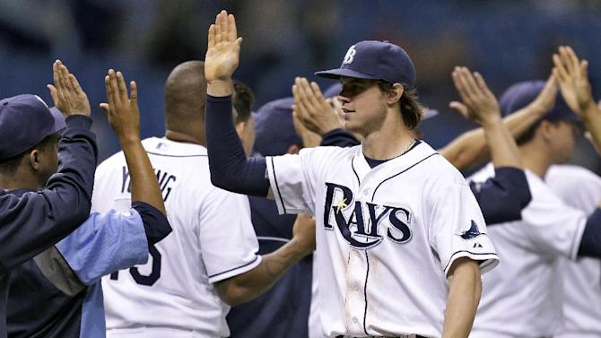 Tampa Bay Rays right fielder Wil Myers high fives teammates after the Rays defeated the Texas Rangers 6-2 during a baseball game Monday, Sept. 16, 2013, in St. Petersburg, Fla. (AP Photo/Chris O'Meara)