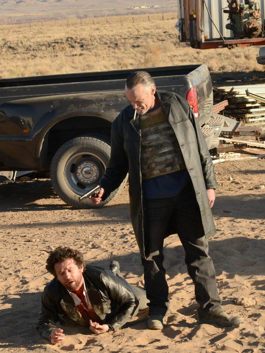 "This image released by AMC shows Declan played by Louis Ferreira, left, about to be shot by Uncle Jack, played by Michael Bowen, in a scene from the fifth season of ""Breaking Bad."" The series finale of the popular drama series airs on Sunday, Sept. 29. (AP Photo/AMC, Ursula Coyote)"