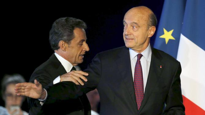 Former French President Nicolas Sarkozy attends a political rally with Bordeaux's mayor Alain Juppe as he campaigns for the leadership of the UMP political party in Bordeaux