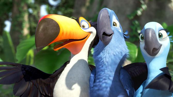 """In this publicity image released by 20th Century Fox, animated characters, from left, Raphael, voiced by George Lopez, Blu, voiced by Jesse Eisenberg, and Jewel, voiced by Anne Hathaway, are shown in a scene from """"Rio.""""  The 20th Century Fox animated family flick """"Rio,"""" featuring the voices of Anne Hathaway and Jesse Eisenberg, led the weekend box office with a healthy $40 million debut, according to studio estimates Sunday, April 17, 2011. (AP Photo/20th Century Fox)"""
