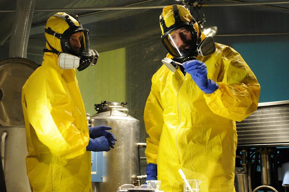 "This image released by AMC shows Jesse Pinkman, played by Aaron Paul, left, and Walter White, played by Bryan Cranston, cooking meth in a home being fumigated in the fifth season of ""Breaking Bad."" The series finale of the popular drama series aired on Sunday, Sept. 29. (AP Photo/AMC, Ursula Coyote)"