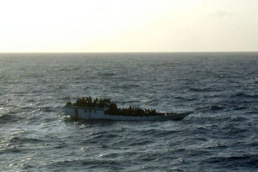 <p>Photo taken by the MV Bison after arriving at the asylum-seeker boat before it capsized. Rescuers plucked 130 people from the ocean after the boat sank en route to Australia, barely a week after another vessel went down in the same area, killing up to 90.</p>
