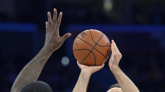 Los Angeles Lakers guard Steve Nash, right, shoots over Oklahoma City Thunder center Kendrick Perkins during the first half of their NBA basketball game, Friday, Jan. 11, 2013, in Los Angeles. (AP Photo/Mark J. Terrill)