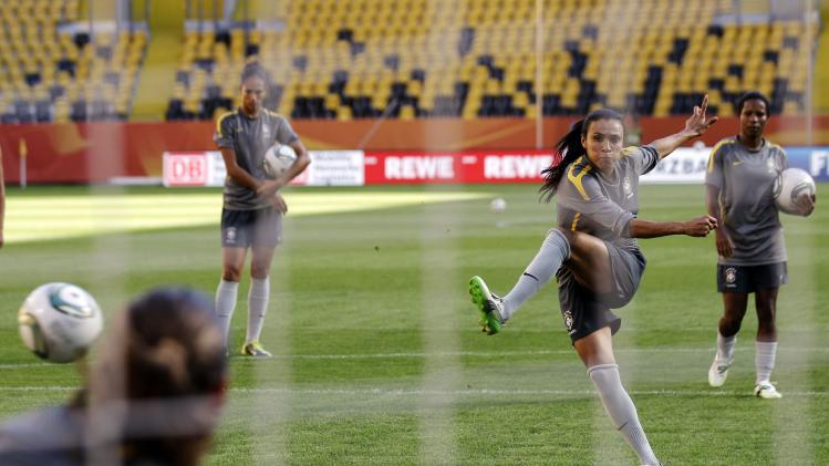 Brazil's Marta, center, practices her penalty shots during a training session in preparation for a quarterfinal match against the United States during the Women's Soccer World Cup in Dresden, Germany, Saturday, July 9, 2011. (AP Photo/Marcio Jose Sanchez)