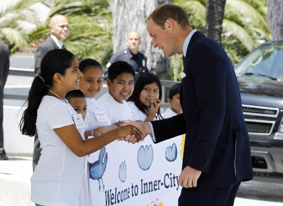 Prince William, the Duke of Cambridge, greets students as he arrives at Inner-City Arts during the royal tour of California in Los Angeles, Sunday, July 10, 2011. (AP Photo/Matt Sayles)