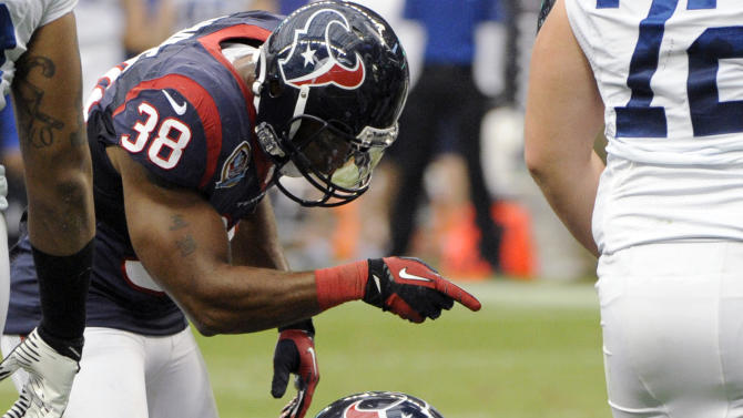 Houston Texans inside linebacker Tim Dobbins (52) recovers a fumble by Indianapolis Colts Mewelde Moore at the goal line as Texans' Danieal Manning (38) gestures in the second quarter of an NFL football game on Sunday, Dec. 16, 2012, in Houston. (AP Photo/Dave Einsel)