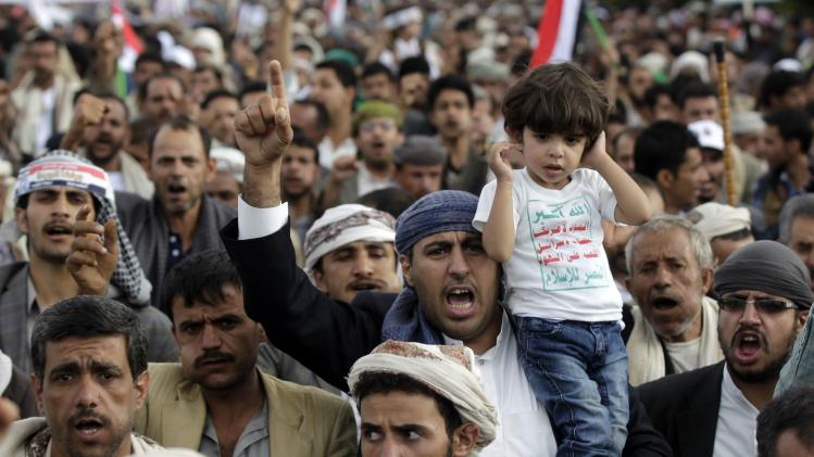 Supporters of the Shi'ite Houthi group shout slogans during an anti-government demonstration in Sanaa