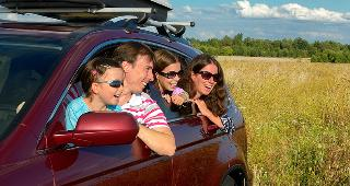 Family in red SUV copyright JaySi/Shutterstock.com