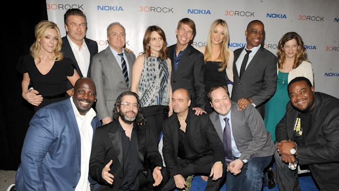 "The cast of '30 Rock' back row, from left, Jane Krakowski, Alec Baldwin, Lorne Michaels, Tina Fey, Jack McBrayer, Katrina Bowden,Keith Powell and front row, from left, Kevin Brown, Judah Friedlander, Scott Adsit, John Lutz and Grizz Chapman attend the Nokia ""30 Rock"" wrap party on Thursday, Dec. 20, 2012 in New York. (Photo by Scott Gries for Nokia/AP Images)"