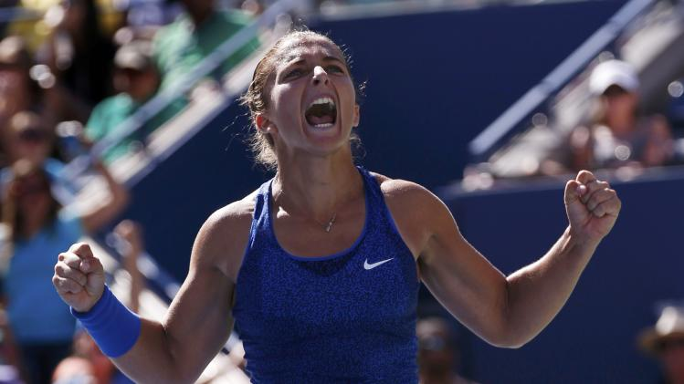 Sara Errani of Italy celebrates after defeating Venus Williams of the U.S. during their match at the 2014 U.S. Open tennis tournament in New York