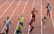 USA's Manteo Mitchell (back 2nd R), Joshua Mance (front 2nd R) Dominican Republic's Gustavo Cuesta and Dominican Republic's Felix Sanchez (back R) compete in the men's 4X400m relay heats at the athletics event during the London 2012 Olympic Games in London. Mitchell suffered a broken leg when running for his team in the 4x400m relay semi-final, but still managed to finish his lap