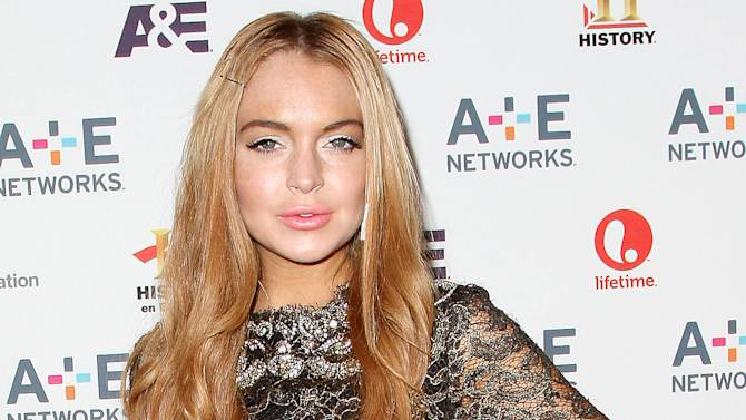 """FILE - In this May 9, 2012 file photo, actress Lindsay Lohan arrives at the A&E Networks 2012 Upfront at Lincoln Center in New York. Amid ongoing legal issues, a recent car crash and run-in with paramedics, Lindsay Lohan has secured her next movie role. Producer Braxton Pope says Lohan will play a starring role in """"The Canyons,"""" with Paul Schrader set to direct. (AP Photo/Starpix, Kristina Bumphrey, file)"""