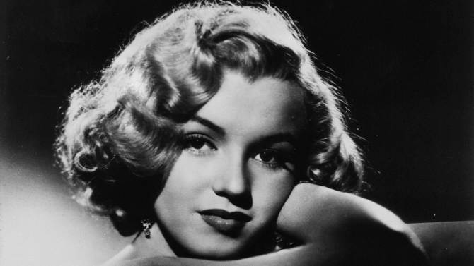 FILE - This undated photo shows actress Marilyn Monroe. In late 2012, the FBI has released a new version of files it kept on Monroe that reveal the names of some of her acquaintances who had drawn concern from government officials and members of her entourage over their suspected ties to communism. (AP Photo, File)